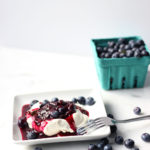 Pavlova with Boozy Blueberry Sauce