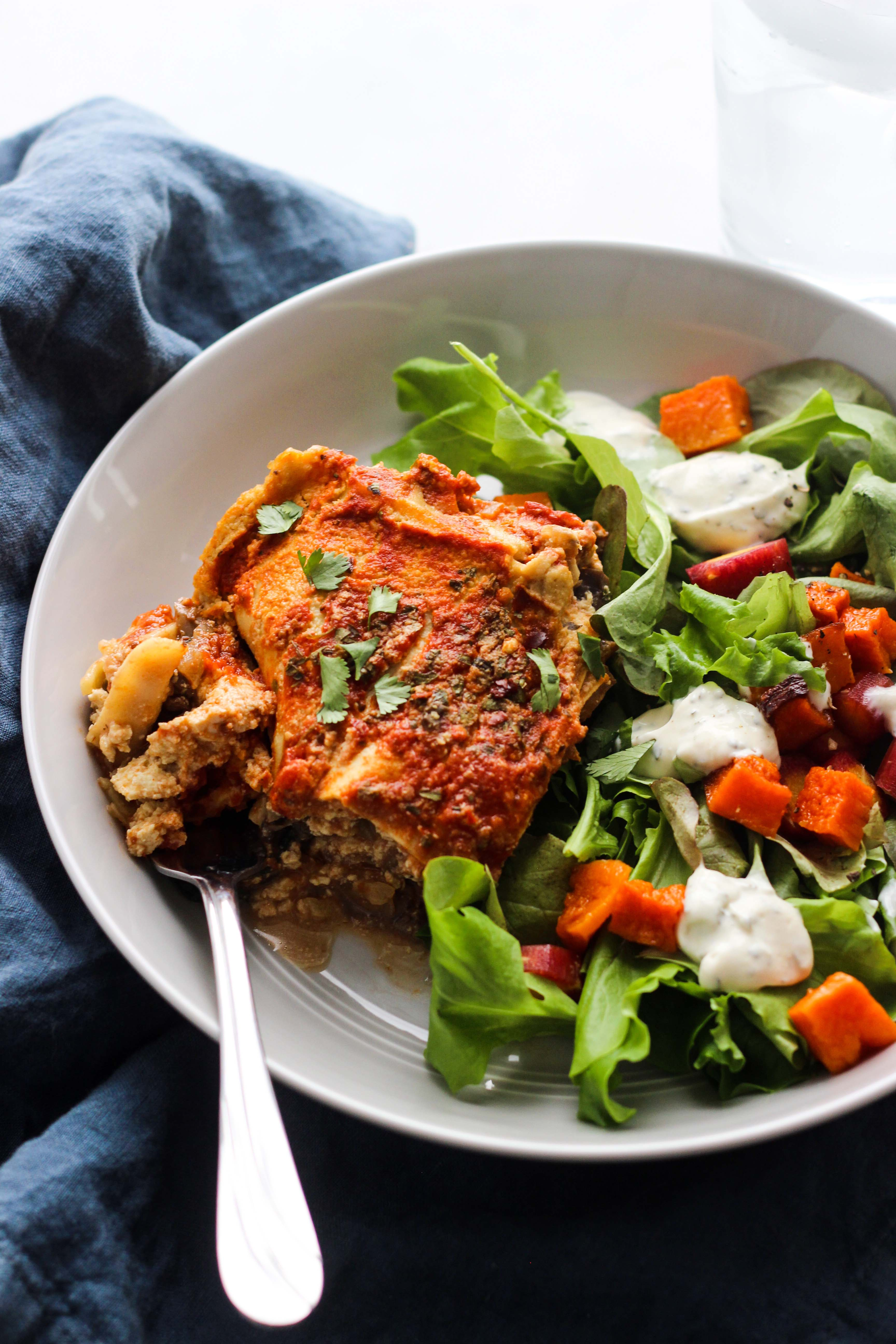 Vegan Spinach and Mushroom Lasagna on plate with salad