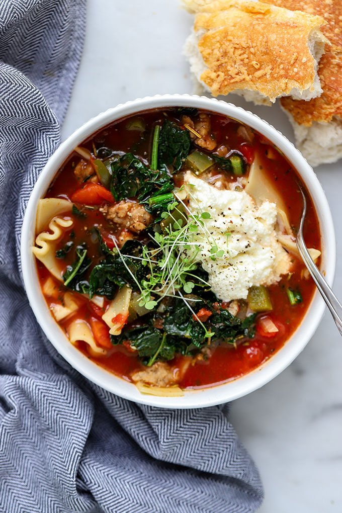 Vegetarian Lasagna Soup in white bowl with blue napkin