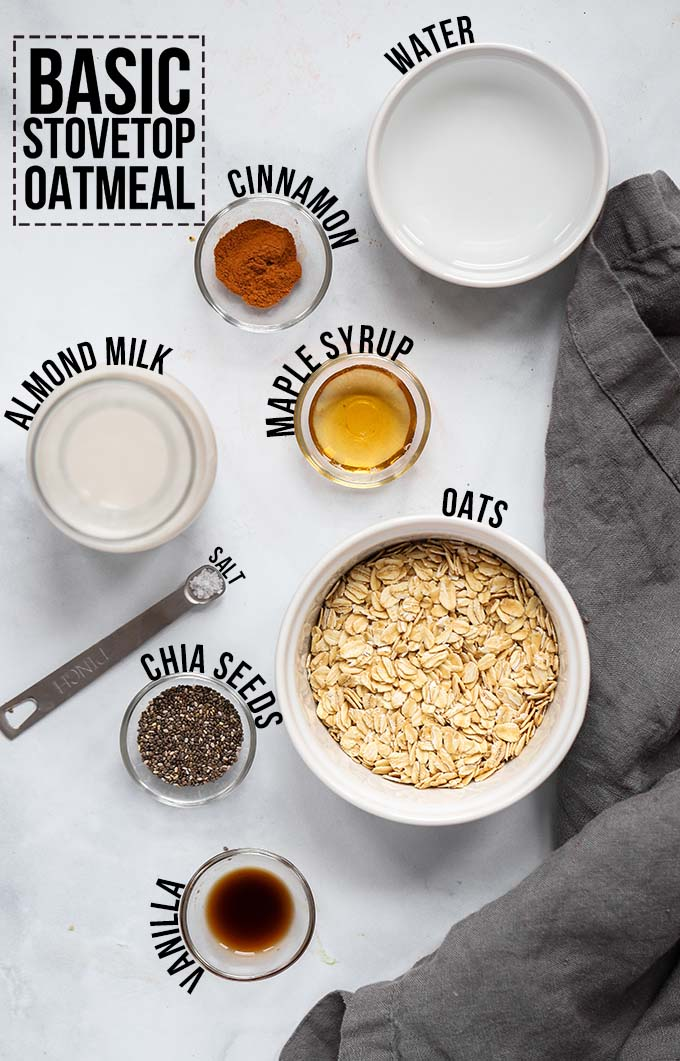 Basic stovetop oatmeal ingredients layer out in bowls with text