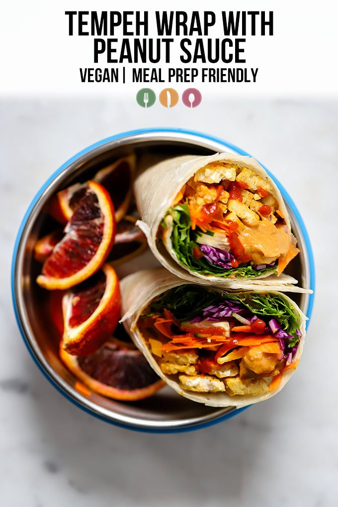 tempeh wrap with peanut sauce in bowl with orange