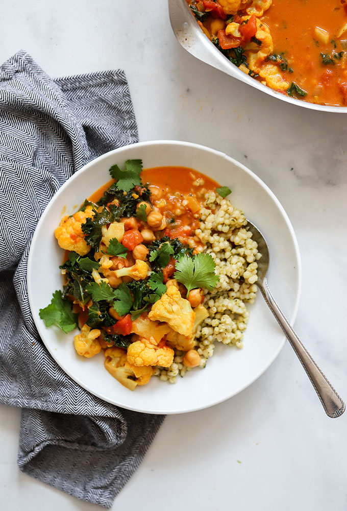 healthy one pot cauliflower curry in bowl with couscous