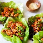 vegan tempeh lettuce cups on white background