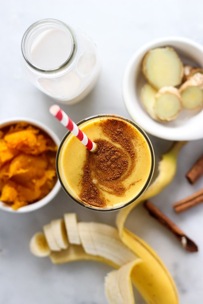 pumpkin smoothie in glass with ingredients