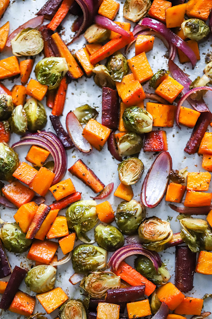 close up balsamic herb roasted vegetables on sheet pan