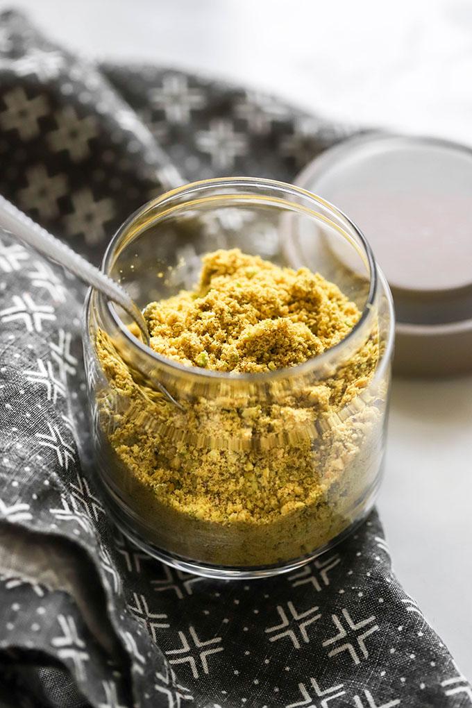 close up of vegan parmesan in jar