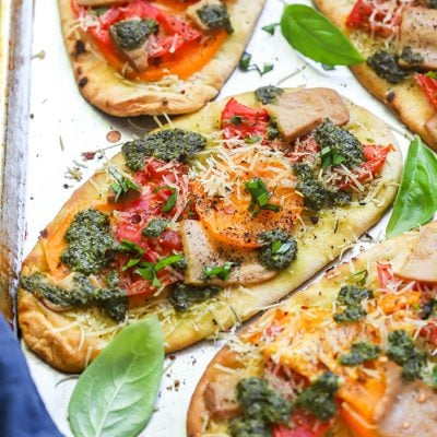Vegan Tomato and Pesto Naan Pizzas