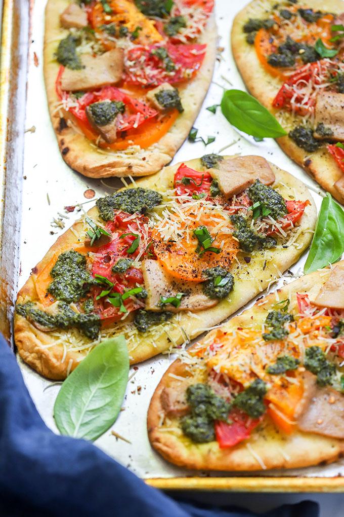 Vegan caprese naan pizzas